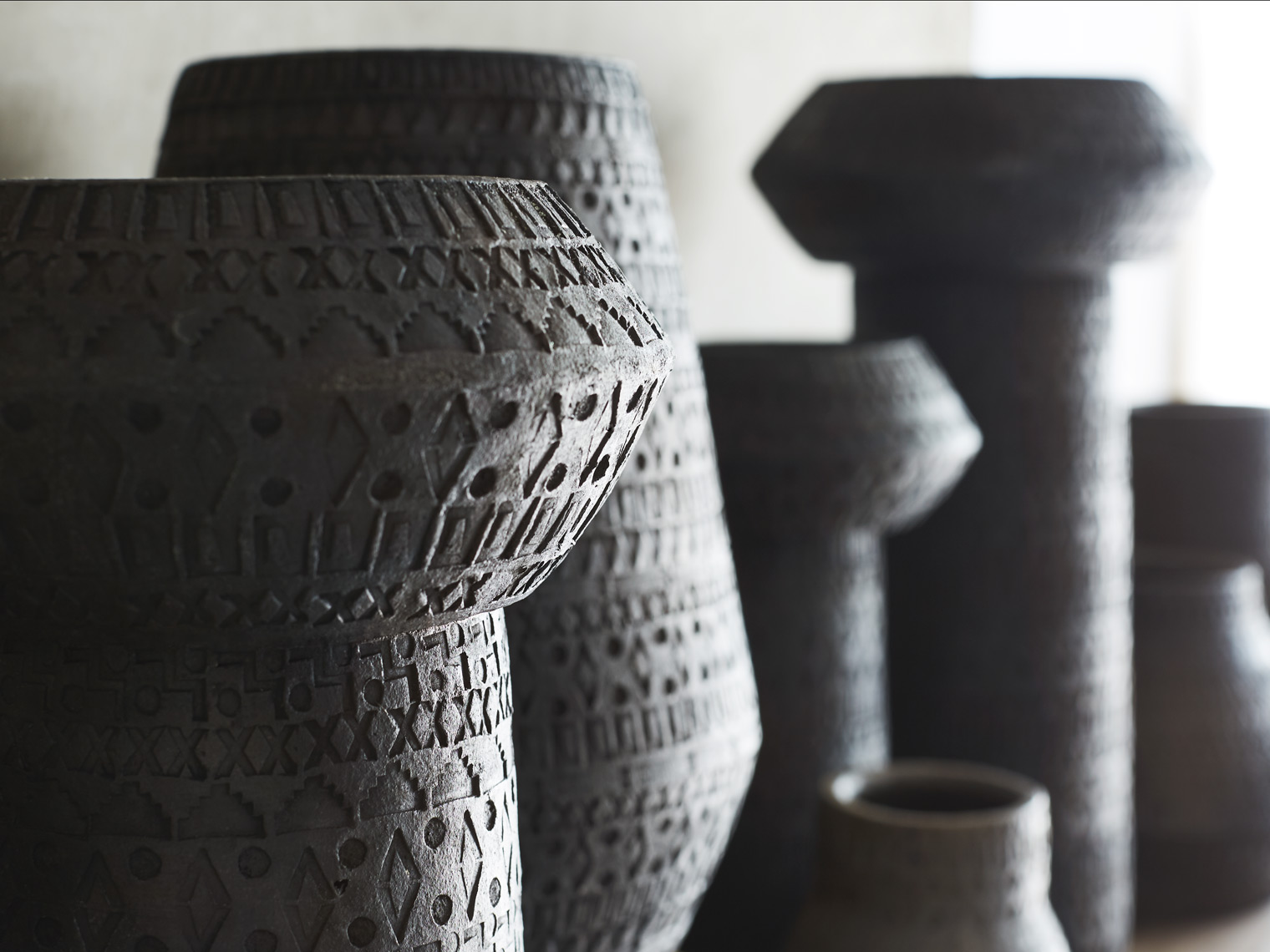 Detail of terra cotta vases and pots on shelf Sean Dagen Photography