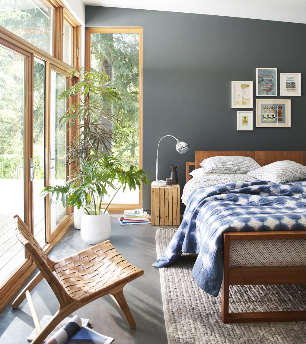 Modern design house bedroom with dark wall bed leather chair windows with a view  art prints