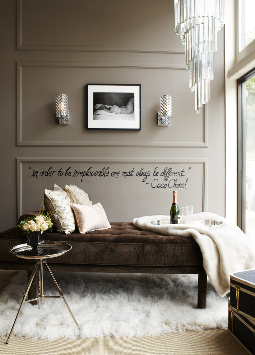 Interior design studio showroom with chaise lounge  rug and Coco Chanel quote on wall Sean Dagen Photography
