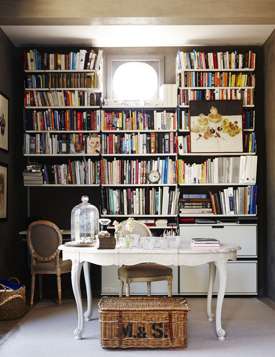 Interior office room in Napa Valley home with white desk books and vintage wicker basket Sean Dagen Photography