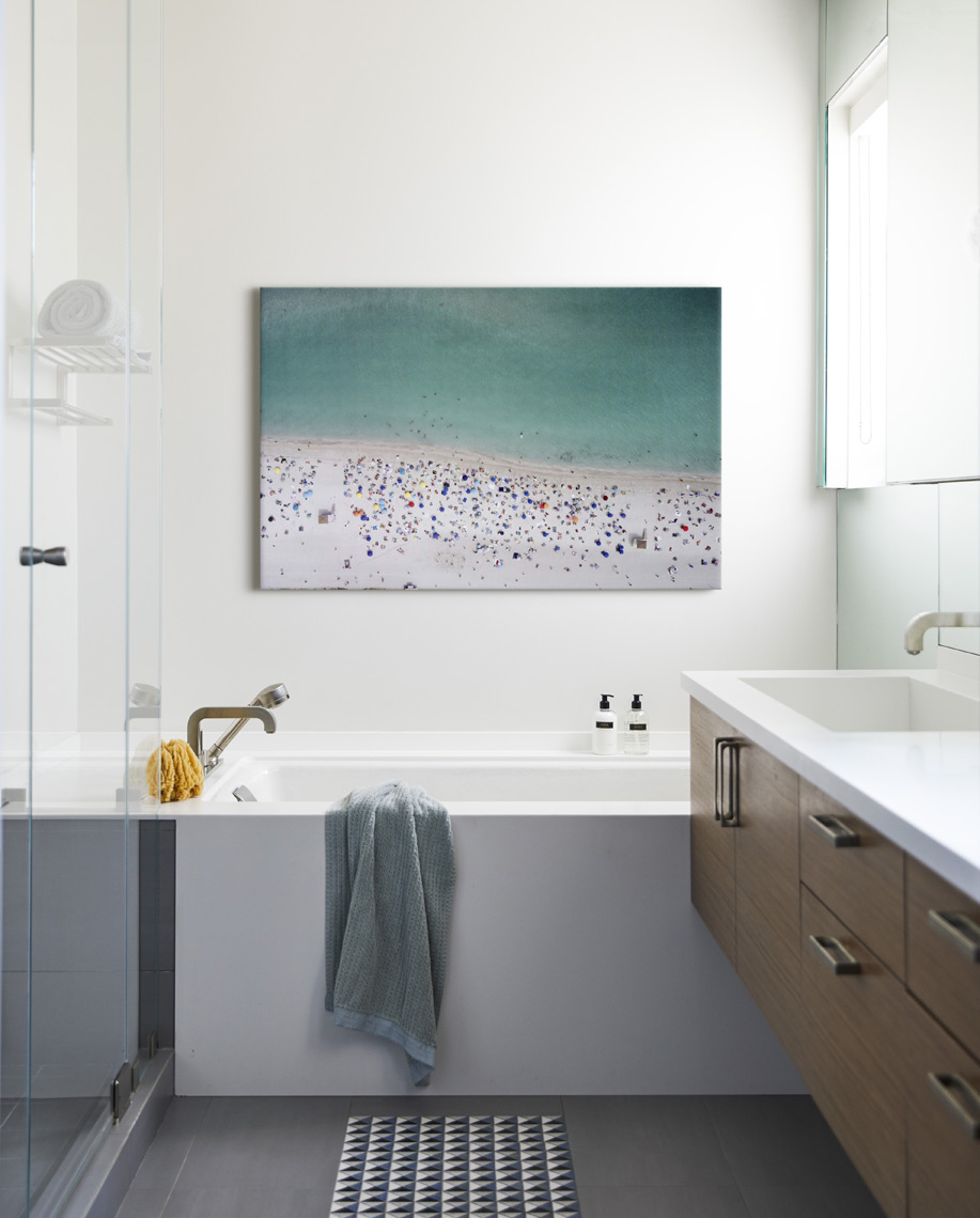 Modern bathroom with art photo above tub Sean Dagen Photography
