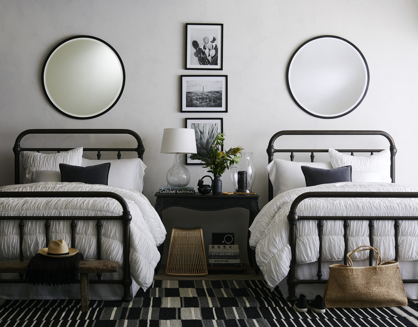 Matching twin beds and mirrors in bedroom