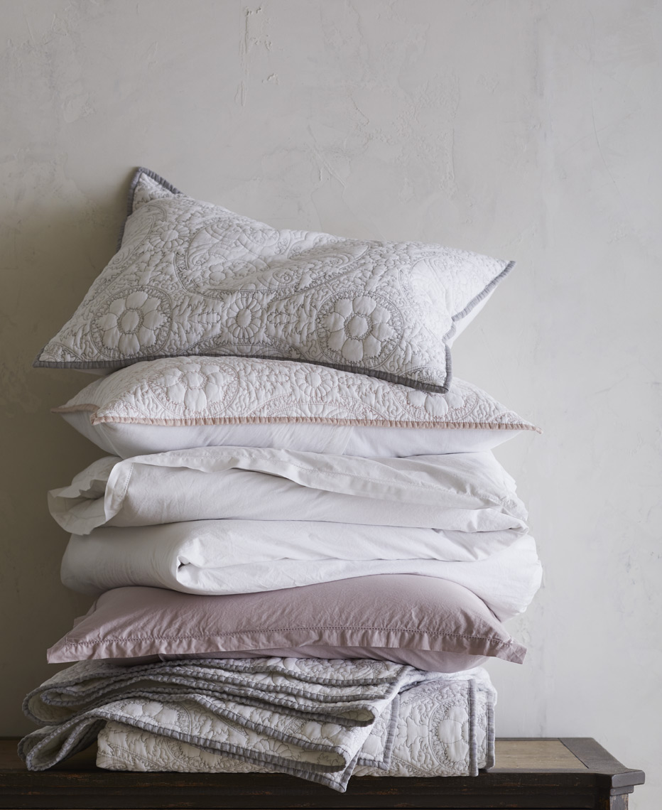Stack of linens and pillow