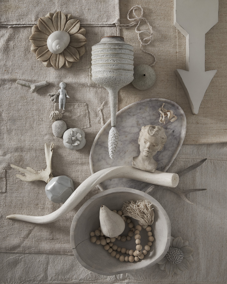 White curios and objects on white linen fabric background Sean Dagen Photography