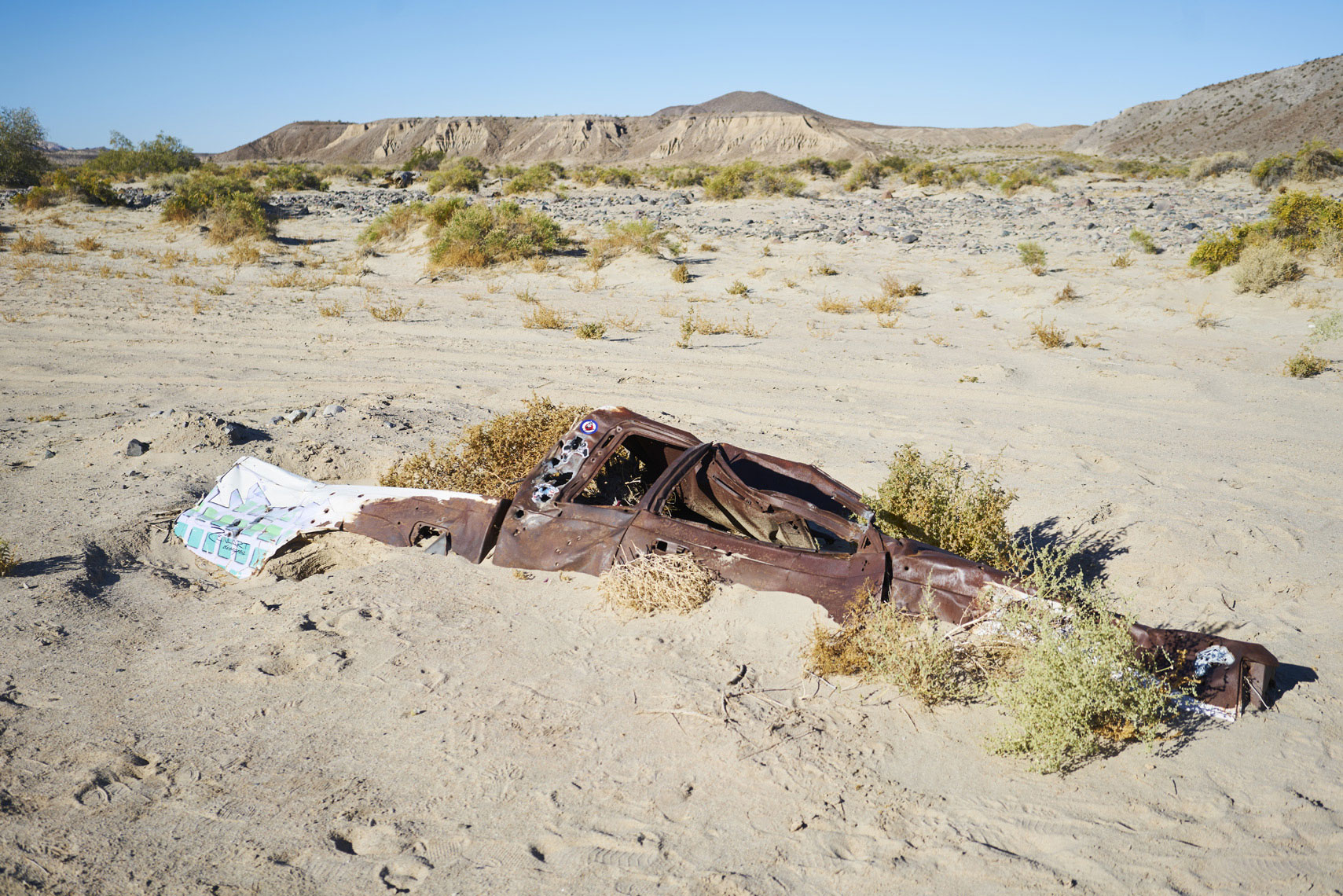 Pickup truck buried by sand in a wash near afton canyon in mojave national preserve Sean Dagen Photography