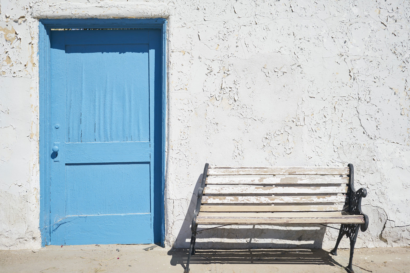Blue door and bench at Amargosa Opera House Death Valley National Park California Sean Dagen Photography