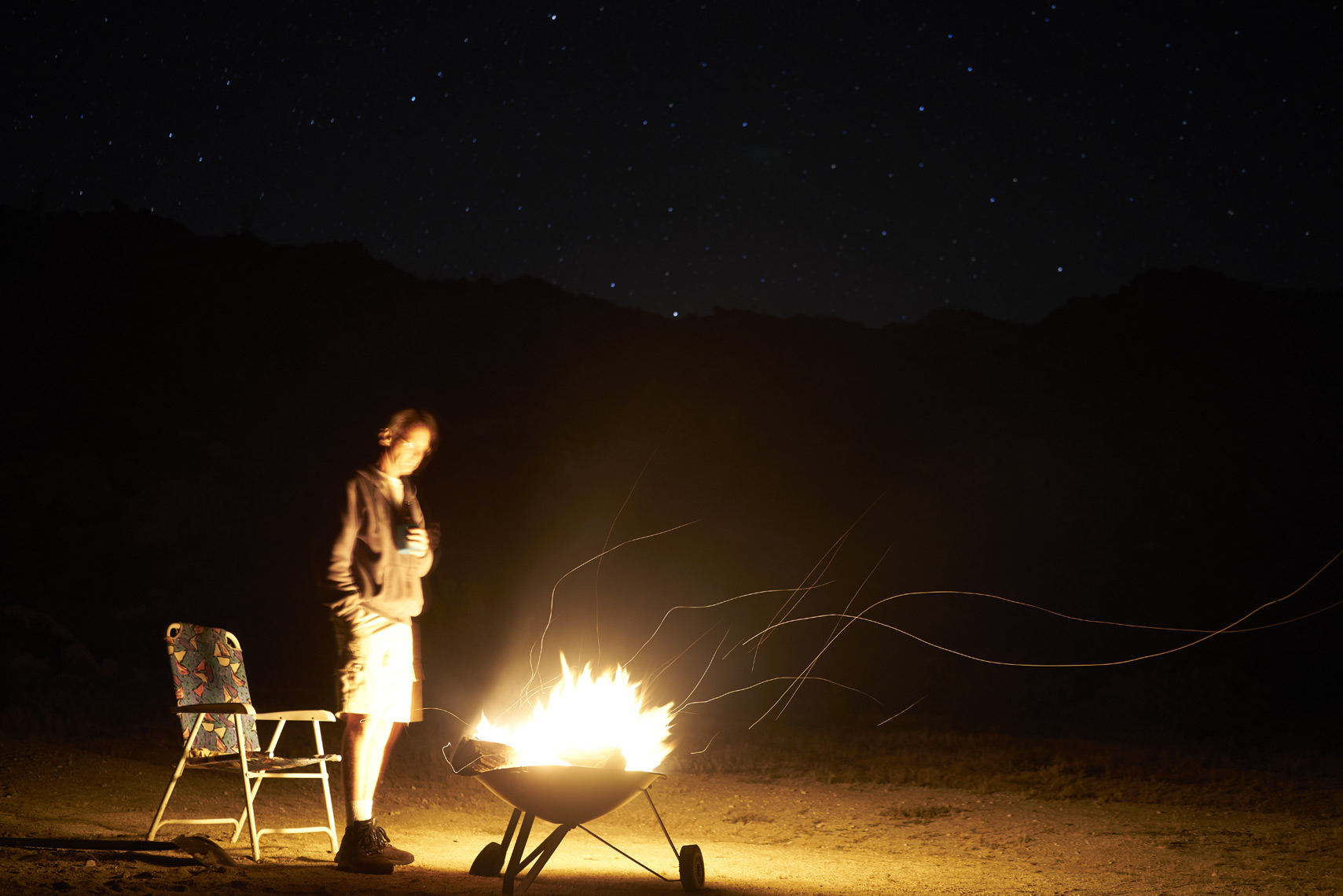 Man with fire at night in Anza-Borrego State Park California Sean Dagen Photography